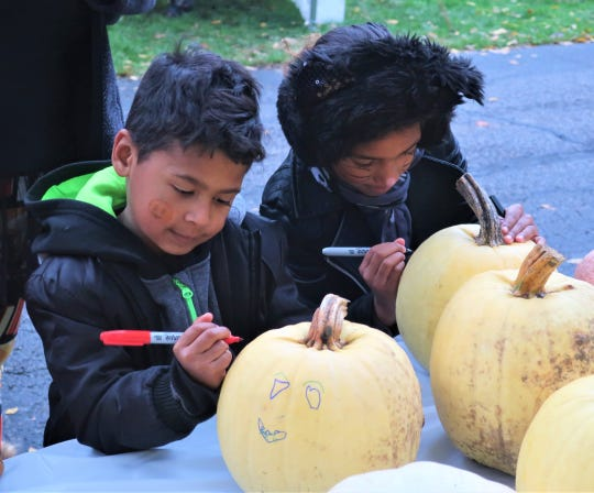 Children decorate pumpkins during a previous free family night at Spiegel Grove.