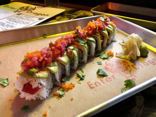 """The Southbeach Roll ($14) with yellowtail, tuna and cucumber inside, avocado and """"kimchi salsa"""" on the outside was a recent special from Enter the Dragon in Cape Coral."""