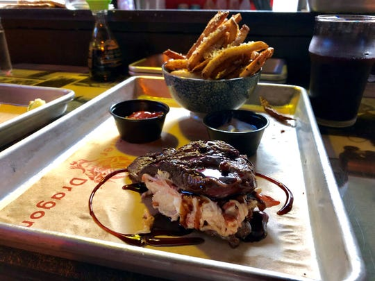 A beef tenderloin ($24) stuffed with a lobster-krab slaw and served with hand-cut fries from Enter the Dragon.