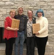 Charolette Baierl, right receives the inaugural Bill Iwen Community and Environmental Justice Award at an event hosted by award sponsor Midwest Environmental Advocates on Oct. 3 at the Kress Pavilion in Egg Harbor. Joining Baierl are, from left, MEA Executive Director Kimberlee Wright and award presenters Lynn and Nancy Utesch of Kewaunee CARES, a Kewaunee County clean water advocacy organization they co-founded with Iwen.