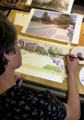 At the Church Street Ramada Inn Monday, Aug. 27, 2001, Greenville urban designer/architect Pat Newell of Overstreet Studios works on a rendering for the proposed Sirrine-Haynie Neigborhood.