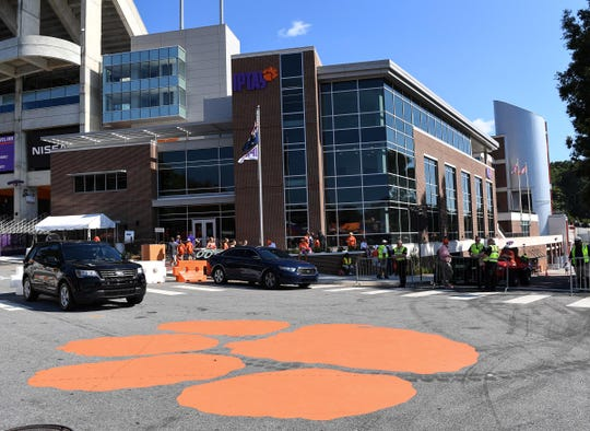 Fans stand outside the IPTAY center at Memorial Stadium in Clemson before the game with Charlotte in September.