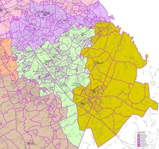 The new assignment zones for students of Mauldin High School in purple, Hillcrest High School in green and Fountain Inn High School in yellow.