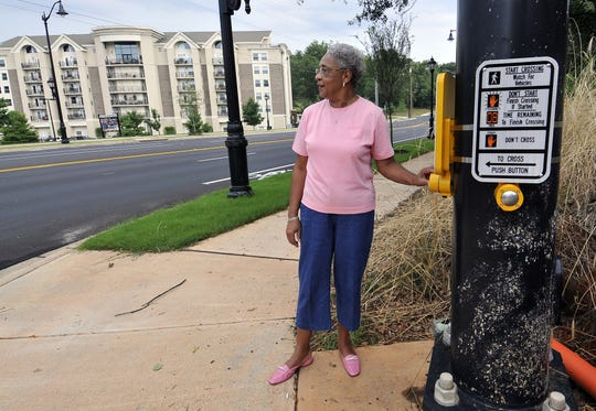 Felsie Harris, long-time president of the Haynie-Sirrine Neighborhood Association, prepares to walk across the newly lighted traffic intersection on Church Street on Thursday, July 5, 2012.
