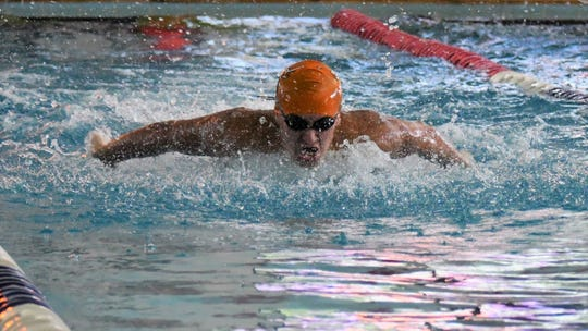 Collin Taylor swims during a meet this season for Mauldin