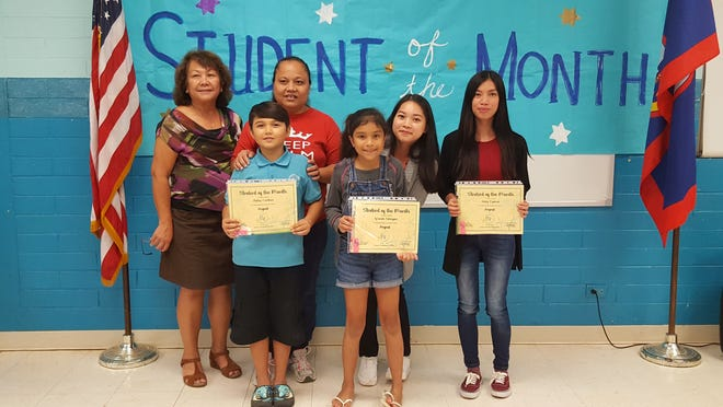 The Guahan Academy Charter School honored its August Student of the Month awardees on Sept. 26. Pictured in front row: Dallas Cauthen and Iy'anah Sahagon. Back row: Teresita Cruz, CRT Guahan Academy Charter School, Connie Maratita, Donabelle Laxamana  and Eileen Prangan. Not pictured: Haley Espinal.