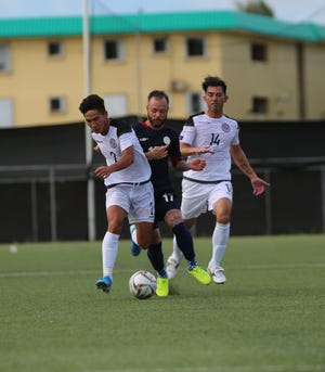 Guam's Isiah Lagutang, left, controls the ball ahead of Philippines' Stephan Schrock, while teammate Dominic Gadia provides support behind him during a Round 2 match of the FIFA World Cup Qatar 2022 Qualifier of the Asian zone last month at the GFA National Training Center in this file photo. The Matao, Guam's national football team, is set to play against China, PR in Guangzhou Thursday and against Syria in Dubai, United Arab Emirates on Oct. 15 in continuation of the qualification round.