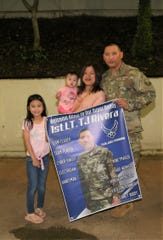 First Lieutenant Tommy Joe Rivera, at right, from the Guam Air National Guard's 254th Air Base Group's Cyber Flight with spouse, Mari Vic and daughters, Zara and Zandra, immediately after arriving on Guam from a deployment in support of Operation Inherent Resolve.