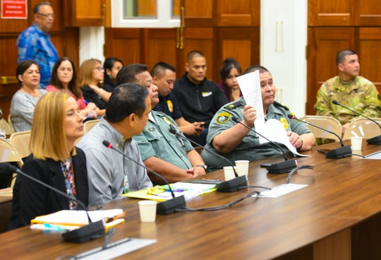 Maj. Antone Aguon holds up a form as he explains how a prisoner is processed for release from Department of Corrections during his testimony at an oversight hearing before lawmakers at the Guam Congress Building in Hagåtña on Wednesday, Oct. 9, 2019.