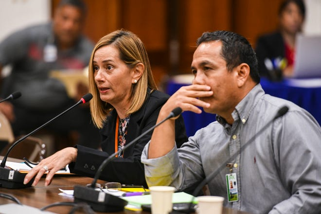 Department of Correction Director Samantha Brennan, left, responds to questions by lawmakers as she and acting Deputy Director Joe Carbullido testify during an oversight hearing at the Guam Congress Building in Hagåtña in this Oct. 9 file photo.