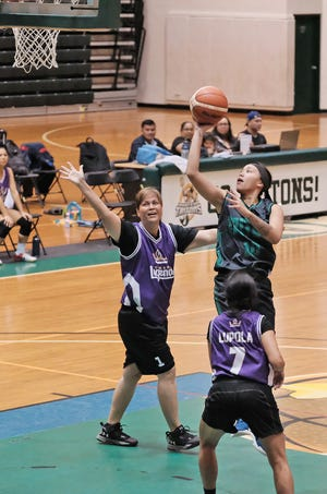 Niah Siguenza scores two points on the floater against Team Legends  during the league semifinals Oct. 7 at the UOG Calvo Field House.. Siguenza had 10 points in the game.