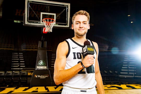 Riley Till stands for a portrait during Iowa basketball during media day in Iowa City Wednesday, Oct. 9, 2019.