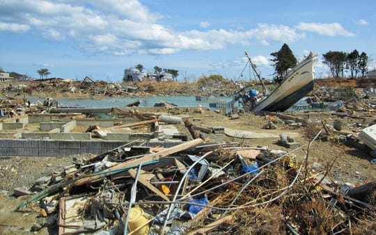 This photo of massive destruction by the 2011 tsunami was taken by poet Arai Takako while helping a friend in Kesennuma, one of several Japanese coastal communities nearly wiped out by the disaster.