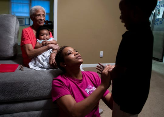 Greyson Gross tries to play hide-and-seek with his mom, Kendra Strickland, in their home in Jackson, Tenn., Wednesday, Oct. 2, 2019. At age 2, Greyson was diagnosed with autism.