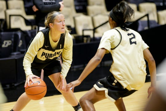 Purdue guard Karissa McLaughlin (1) dribbles as she is guarded by Purdue guard Bria Harmon (2) during practice, Wednesday, Oct. 9, 2019 at Mackey Arena in West Lafayette.