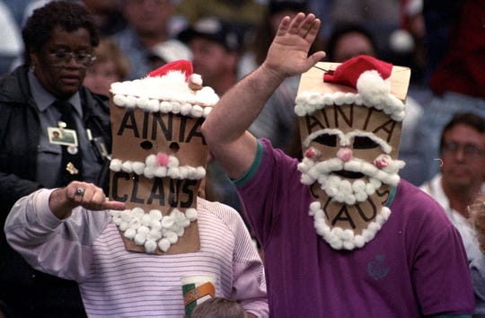 New Orleans Saints fans are shown wearing bags on their heads during the 1995 season.