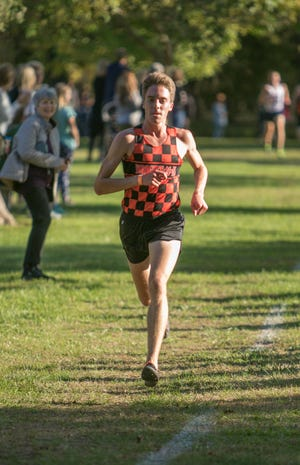 Jack Spamer of Brighton leads Livingston County with a time of 15:02.7.