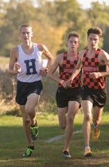 (From left) Hartland's Riley Hough races Brighton's Jack Spamer and Zach Stewart at Huron Meadows Metropark on Tuesday, Oct. 8, 2019.