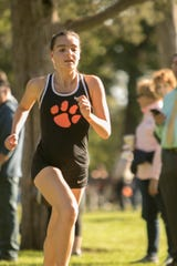 Brighton's Katie Carothers won a cross country meet against Hartland and Howell at Huron Meadows Metropark Tuesday, Oct. 8, 2019.