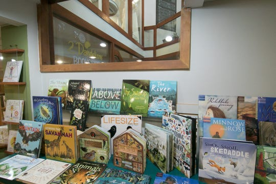Several windows in the new 2 Dandelions Bookshop, shown Wednesday, Oct. 9, 2019, face up to the lobby from their location at 209 W. Main St. in downtown Brighton.