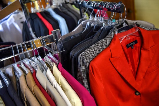 A wide selection of business professional jackets are on display at the Women's Center of Greater Lansing on Monday, Oct. 7, 2019, in Lansing.