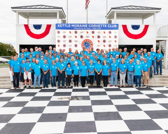Kettle Moraine Corvette Club's official 50th anniversary member photo taken at Road America's Winner's Circle.
