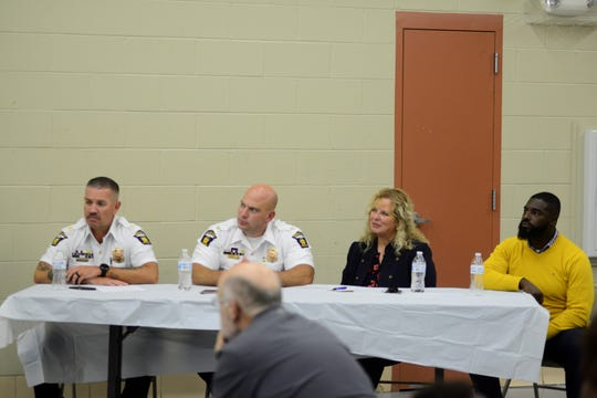From left, Mansfield Police Assistant Chief Joe Petrycki, Chief Keith Porch, Safety-Service Director Lori Cope and Alomar Davenport, Democratic candidate for Mansfield City Council's Fourth Ward seat, attend a community meeting held on Tuesday.