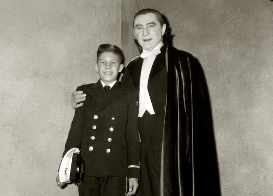 """Bela Lugois Jr., wearing school uniform from Elsinore Naval and Military School in California, visits his father on the set of """"Abbott and Costello Meet Frankenstein."""""""