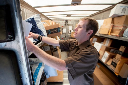 Ups Package Delivery Driver Pay >> In Fedex S Hometown Ups Building Grapples With Wave Of