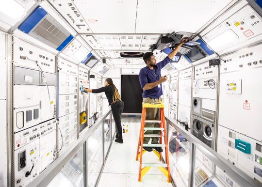 Archivists Dewana Oliver and Brian Johnson set up the 