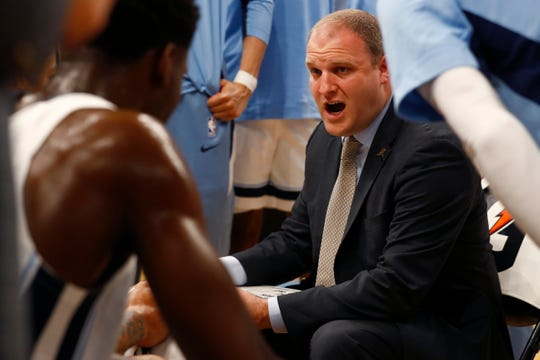 Memphis Grizzlies Head Coach Taylor Jenkins talks to his team during a timeout in their game against the New Zealand Breakers at the FedExForum on Tuesday, Oct. 8, 2019.