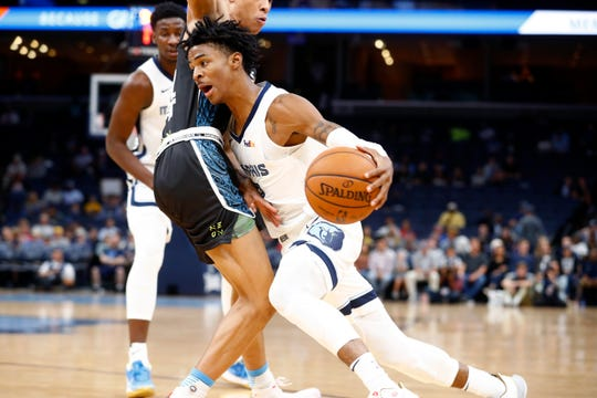 Memphis Grizzlies guard Ja Morant drives past New Zealand Breakers guard RJ Hampton during their game at the FedExForum on Tuesday, Oct. 8, 2019.