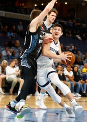 Memphis Grizzlies guard Grayson Allen drives against New Zealand Breakers guard Tom Abercrombie during their game at the FedExForum on Tuesday, Oct. 8, 2019.