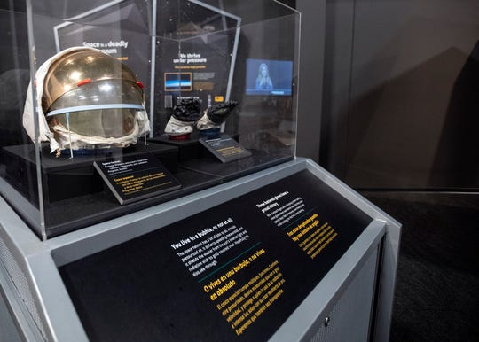"Graceland's 10,000-square-foot space exhibit ""Journey to Space"" features artifacts including Neil Armstrong helmet and pair of gloves."
