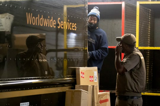 Pre-loader Anthony Mitchell (left) talks with a delivery driver Wednesday, Oct. 9, 2019, at UPS' package center and hub on Carrier Street in Memphis. The facility is separate from UPS' airport hub, which the company plans to expand.