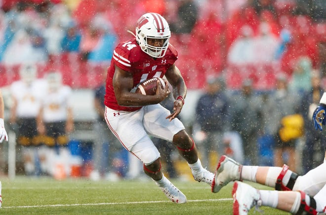 Oct 5, 2019; Madison, WI, USA; Wisconsin Badgers running back Nakia Watson (14) rushes with the football during the third quarter against the Kent State Golden Flashes at Camp Randall Stadium. Mandatory Credit: Jeff Hanisch-USA TODAY Sports
