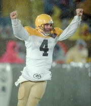 Green Bay Packers quarterback Brett Favre celebrates after scoring a touchdown against the Chicago Bears on a 36-yard run in the second quarter on Oct. 31, 1994, in Chicago.