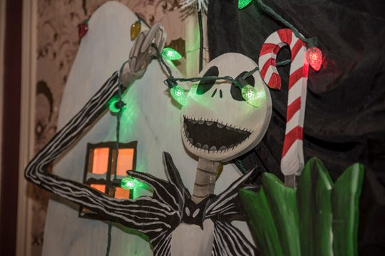 "A display of Christmas Town, featured in the movie ""The Nightmare Before Christmas,"" will be on exhibit for two showings of movie Oct. 20 at the Riverside Theater. The Milwaukee Symphony Orchestra will play the score. Paul Tennessen shared scenes from his annual Halloween display in Bay View for the event."