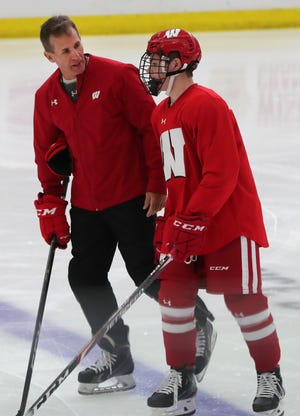 Wisconsin men's hockey coach Tony Granato talks with forward Cole Caufield during a practice at LaBahn Arena. Caufield is part of a heralded freshman class for the Badgers.