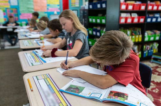 Third-graders at Lake Country School in Delafield practice cursive writing on Tuesday, Oct. 8, 2019. Lake Country School registered a 92.6 score in the 2018-19 state report cards, the highest score in the state.