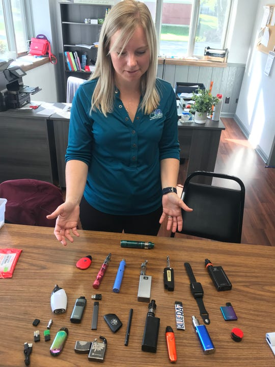 Your Choice To Live Inc. executive director Ashleigh Nowakowski talks about the different types of vaping devices that kids have been caught with. The display of the devices is part of the group's presentations on vaping.