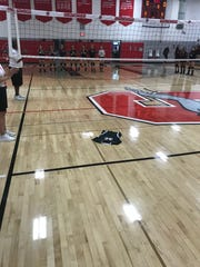 Megan Frieseke's No. 32 jersey was laid on her traditional spot on Shorewood High School's volleyball court ahead of the girls' volleyball team's match against   West Allis Central Oct. 8.