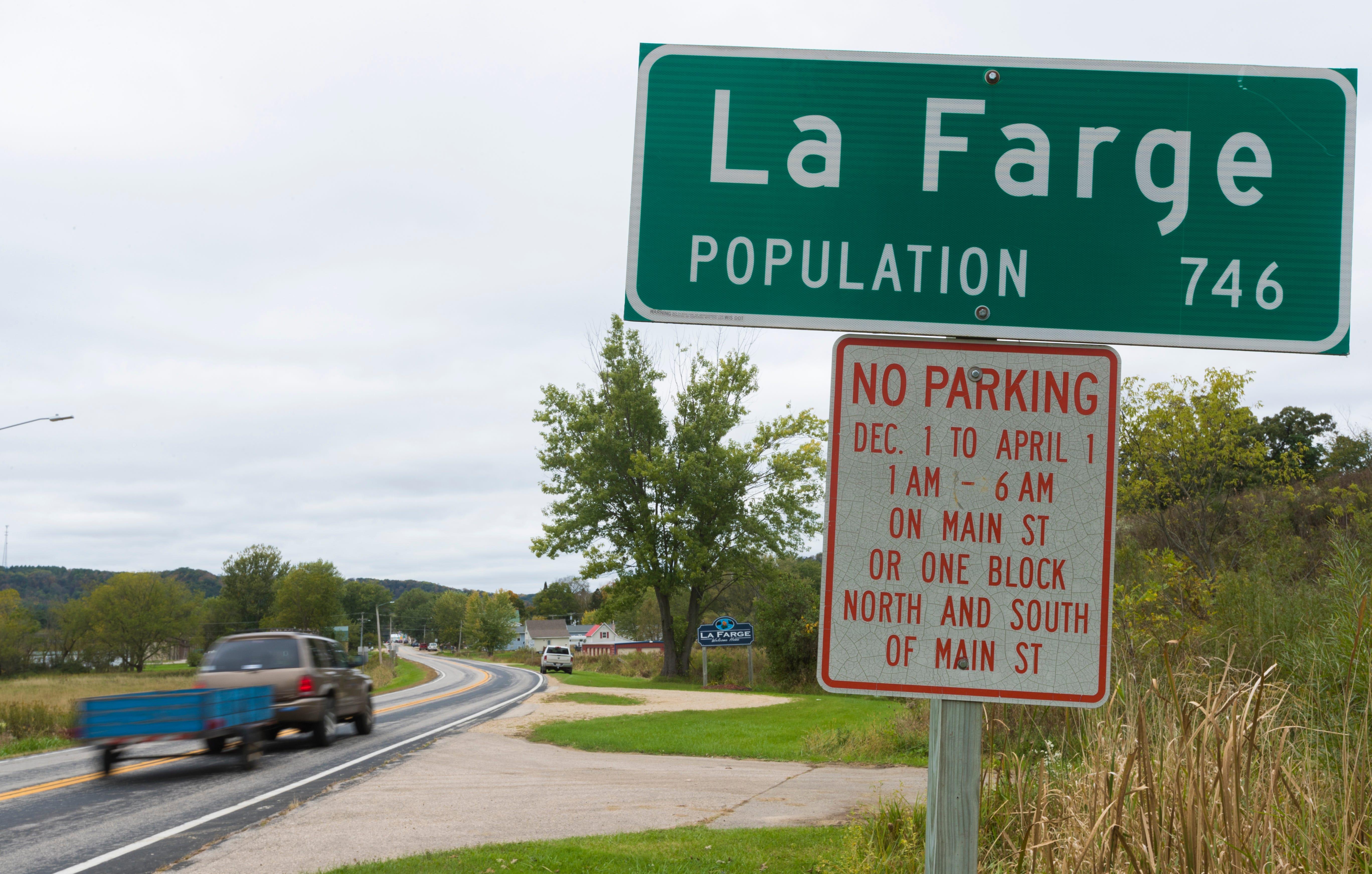 A motorist passes the La Farge city limits sign.