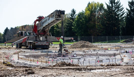 Construction workers prepare to pour concrete for the splash pad attraction at Village Park in Sussex on Tuesday, Oct. 8, 2019. The project is on schedule to be completed by Memorial Day 2020.