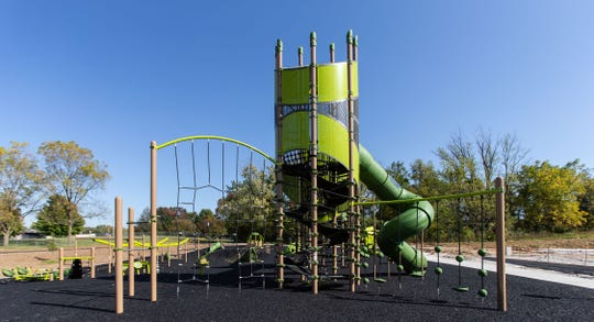 The playground at Village Park in Sussex features a variety of multi-level attractions as seen on Tuesday, Oct. 8, 2019. The spongey black surface will be covered with a colorful poured rubber finish.