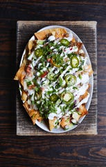 Maneet Chauhan likes to take foods familiar to Americans and put an Indian twist on them, as with these nachos.