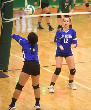 Cotter's Mai Tathong passes as teammate Tylar Coots looks on during action earlier this season.