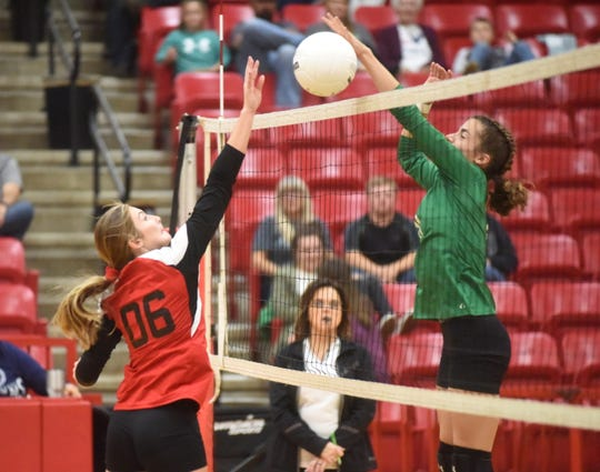 Flippin's Emily Davenport and Yellville-Summit's Jacey Davenport battle at the net during action Tuesday night.
