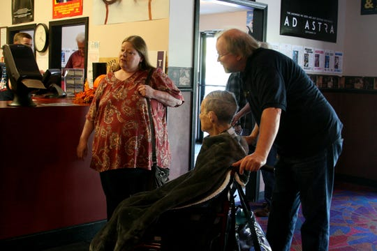 "Sun Valley General Manager Mark McNew (right), rolls his uncle, Henry McCalmont, to the concession stand on Friday before seeing the movie ""Ad Astra"" on Friday afternoon. Joining them is his daughter, Tammy McCalmont (far left), owner of the Sun Valley and The Baxter Theater."