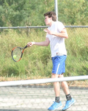 Mountain Home's Jake McGehee returns a shot during action earlier this season.